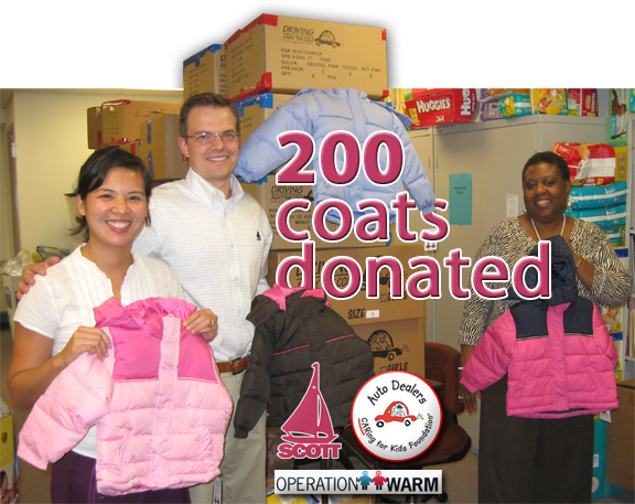 Picutred with their new coats are (left) Michelle Sanchez, Special Projects Assistant, your humble Sconda Blogger, Douglas P. Scott in the middle and to the right is Beatriz Polk, Business Manager for MCHC.